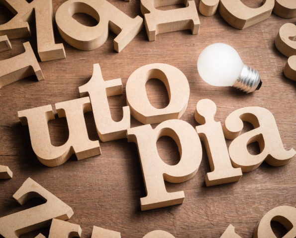 UTOPIA wood word in scattered wood letters with glowing light bulb